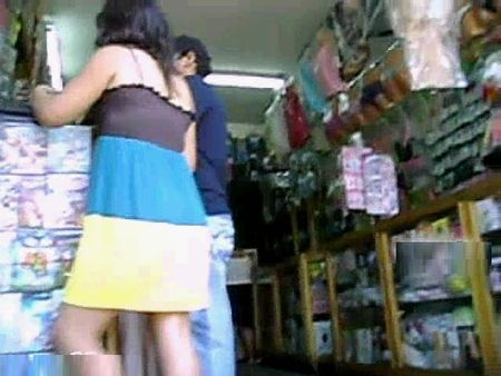 In the market, the girl peeped under her skirt