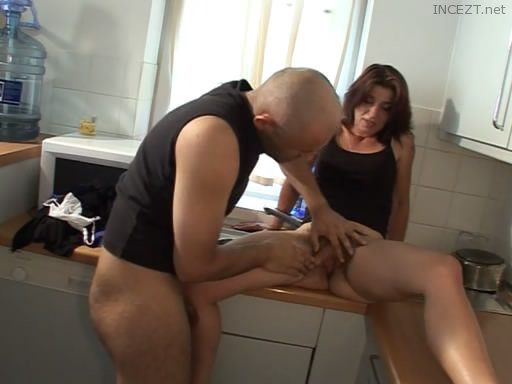 Sex of mother and son at the kitchen