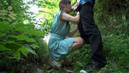 Asian doing blowjob in the forest