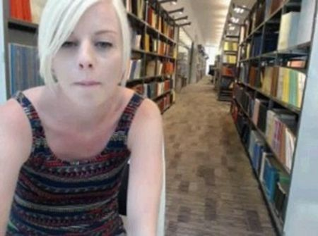 Cute little girl on webcam - masturbation in a library