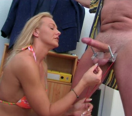 Ball streching handjob